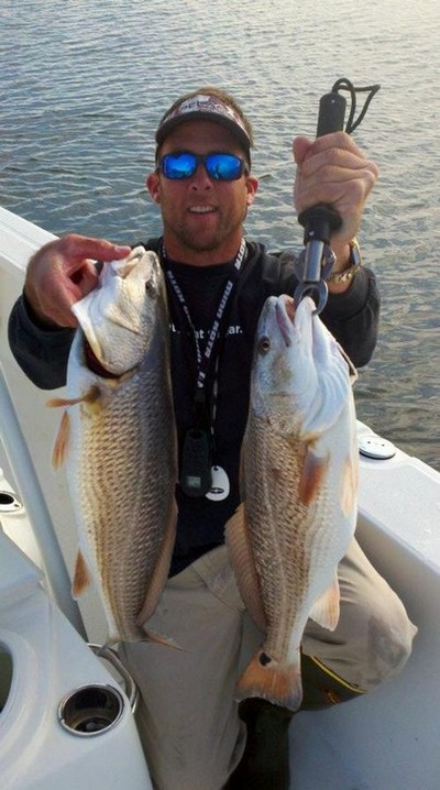 Captain Brandon Sauls with some nice inshore redfish caught this winter.