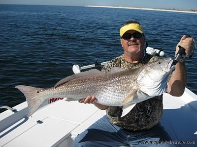 Jerry holds up his biggest red fish ever.