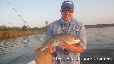 Capt. John with a nice slot redfish