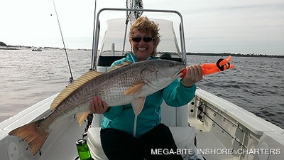 Karen is all smiles after landing this big redfish