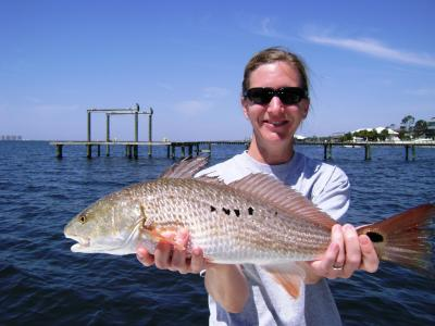 Danielle with her first ever Red Fish!