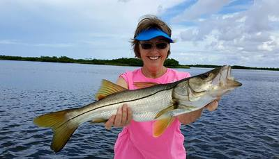 Sue with a nice 28 inch snook.
