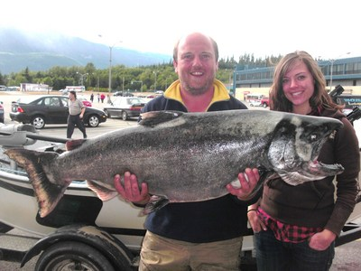 Photo of the Week shows pro angling guide Andreas Handl holding up his client Tamara�s 50-pound Chinook (King) Salmon landed on the Kitimat River on July 15, 2010.  Andreas reports Tamara did an awesome job landing this brute of a fish.  She was fishing w