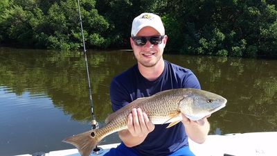 Ben is all smiles after landing this nice redfish