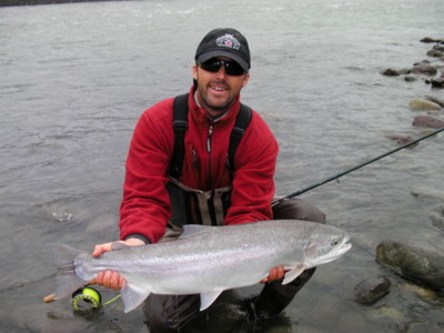The photo of week shows Gill McKean owner of Westcoast Fishing Adventures with a beautiful bright, wild Steelhead landed last fall.