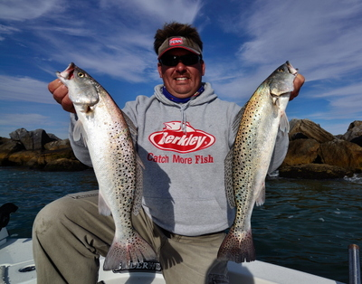 Capt. Jot with two Trophy Speckled trout!