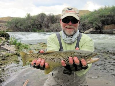 Capt. Rick Grassett with a Beaverhead River brown trout caught and released on a fly while fishing with guide Tom Caffrey out of Crane Meadow Lodge, MT.