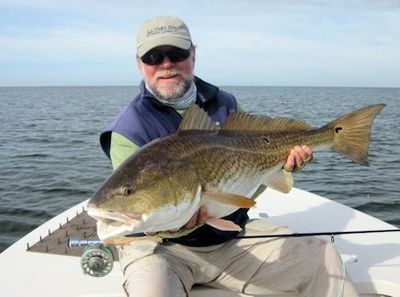 Capt. Rick Grassett with a big Louisiana redfish caught and released on a fly while fishing with Capt. Al Keller out of Hopedale, LA.