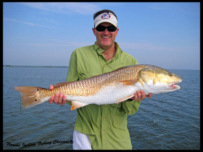 Kelly from Japan with a nice Mosquito Lagoon Redfish