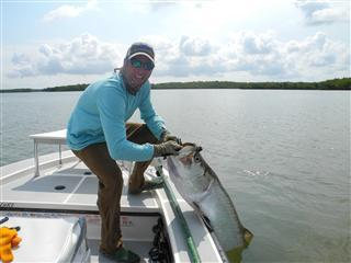 Scott with a tarpon. 14 minutes to the boat!