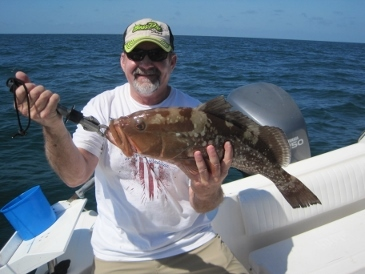 24-inch red grouper, on squid, 24 miles west of New Pass
