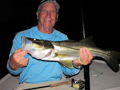 Gary Mintz, from CO, caught and released this snook on a Grassett Snook Minnow fly while fishing Sarasota Bay lighted docks with Capt. Rick Grassett.