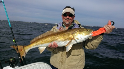 Kevin is all smiles after landing this big Pensacola Bay Redfish