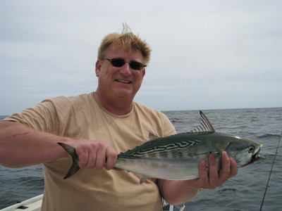 Capt. Paul Eidman with a 6lb Albie that fell for a epoxy minnow