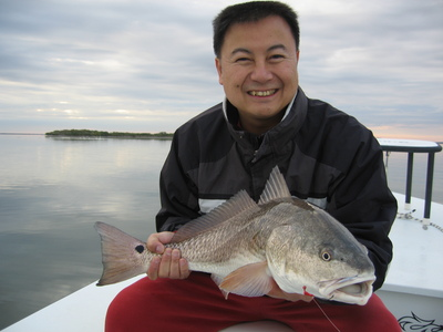 Ninh with one of his many redfish of the day.