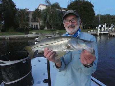 Steve Cohn, from Australia, with a nice snook caught and released on a fly while fishing Sarasota Bay with Capt. Rick Grassett.