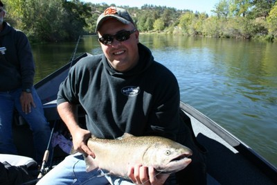 Kash from Yreka, Calif., with his first salmon caught with guide Andy Martin of www.wildriversfishing.com