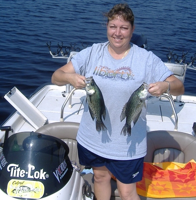 Kim Newton shows some of Lake Lochloosa fish