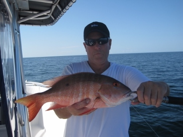 Larry Jones with his 18-inch mutton snapper