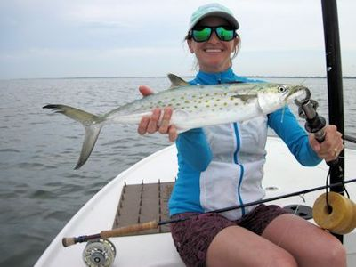 Lindsey Lewis, from CO, with a nice Spanish mackerel caught on an Ultra Hair Clouser fly while fishing Sarasota Bay with Capt. Rick Grassett.