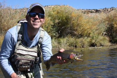 Steve Baird showing of a fish from the backwates on the Juan.