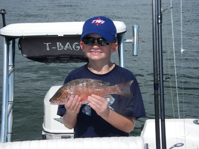 A happy young man with a snapper