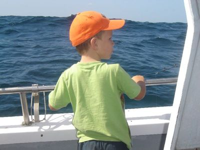 A youngster anticipating the catch