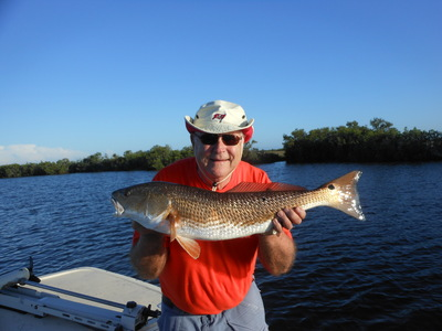 Fred with a big red fish