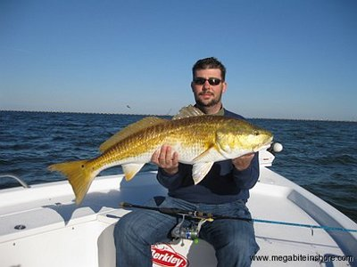 Justin shows off his first redfish